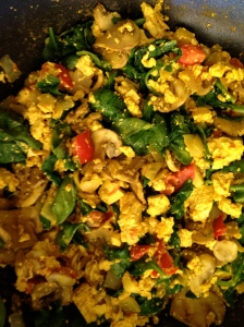 Tofu Scramble! Just saute veggies of choice, crumble in a block of extra firm tofu,  sprinkle with nutritional yeast, tumeric and sea salt.