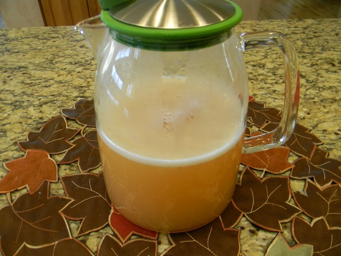 Pour into a pitcher, straining the pulpy stuff out.